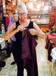 Jeanne with Dress, Shop Owner in Background